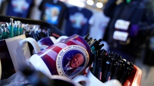 Gi Chung sets up his souvenir stand with Joe Biden memorabilia ahead of the inauguration ceremony, on Jan. 20, 2021. (David Goldman / AP)