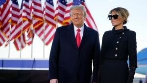 President Donald Trump and first lady Melania Trump look at supporters before boarding Air Force One at Andrews Air Force Base, Md., Wednesday, Jan. 20, 2021.(AP Photo/Manuel Balce Ceneta)