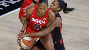 Atlanta Dream's Betnijah Laney, left, is defended by Las Vegas Aces' Lindsay Allen during the first half of a WNBA basketball game Saturday, Sept. 5, 2020, in Bradenton, Fla. (AP Photo/Mike Carlson)