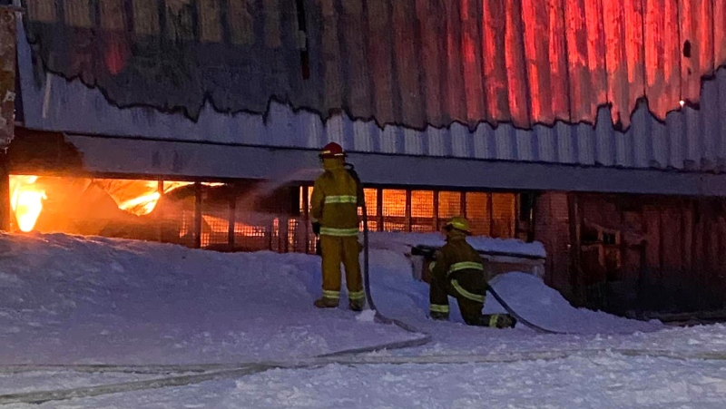 Firefighters battle a fire engulfing the Arctic Co-op grocery and retail store in Igloolik, Nunavut on Wednesday, Jan. 20, 2021. THE CANADIAN PRESS/HO-Qaatani Sarpinak Mandatory Credit