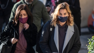 Olympic sailing champion Sofia Bekatorou, right, arrives at the prosecutor's office in Athens, on Wednesday, Jan 20, 2021. (AP Photo/Petros Giannakouris)