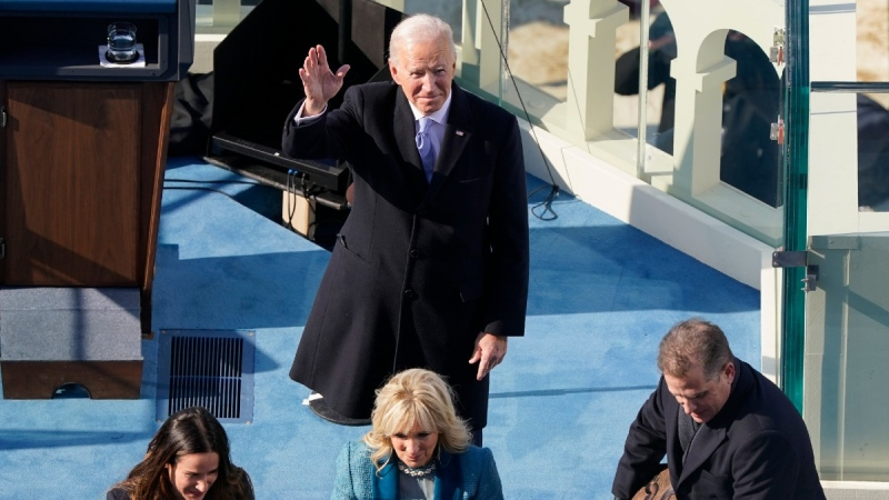 U.S. President Joe Biden waves after taking the oath of office from Supreme Court Chief Justice John Roberts, on Jan. 20, 2021. (Susan Walsh / AP / Pool)