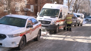 Fire crew remained at the scene Wednesday morning of an overnight fire on Kirkwood Avenue. (Jim O'Grady/CTV News Ottawa)