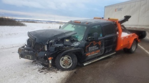 Slavko Hardi says a semi lost control on Highway 16 and struck his tow truck. (Facebook)
