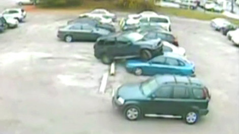 A surveillance camera captured this scene in the parking lot of Extreme Fitness in Thornhill, Ont. on Oct. 22, 2009.