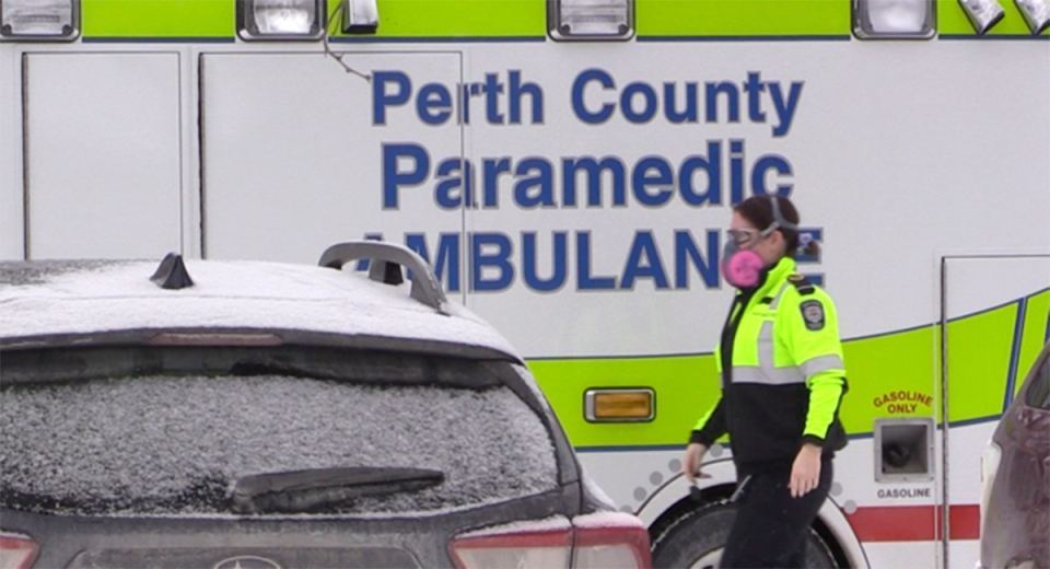 A paramedic is walks in front of an ambulance in Listowel, Ont. on Wednesday, Jan. 20, 2021. (Scott Miller / CTV News)