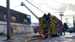 The fire in a commercial building at 105 Avenue and 116 Street was reported around 11 a.m. Wednesday.