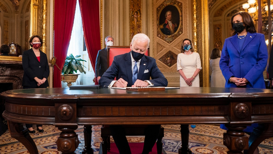 U.S. President Joe Biden signs documents