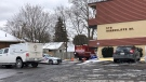 Investigators work at the scene of a motel fire in London, Ont. on Wednesday, Jan. 20, 2021. (Jim Knight / CTV News)