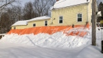 Wendy Richards's home in Manotick being supported by a pile of gravel under a tarp. (Dave Charbonneau/CTV News Ottawa)