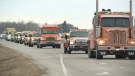 Tow truck driver reminds motorists to slow down