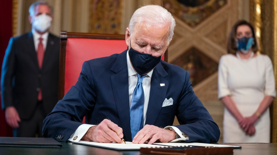 U.S. President Joe Biden signs three documents including an inauguration declaration, cabinet nominations and sub-cabinet nominations in the President's Room at the US Capitol after the inauguration ceremony, Wednesday, Jan. 20, 2021, at the U.S. Capitol in Washington. (Jim Lo Scalzo/Pool Photo via AP)