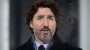Prime Minister Justin Trudeau speaks during a news conference outside Rideau cottage in Ottawa, Tuesday, January 19, 2021. THE CANADIAN PRESS/Adrian Wyld
