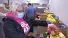 UHC food bank coordinator Lynda Davidson preparing food boxes to distribute to residents in Windsor, Ont. on Wednesday, Jan. 20, 2020. (Chris Campbell/CTV Windsor)