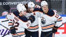 Edmonton Oilers centre Leon Draisaitl (29) celebrates his goal with teammates Jesse Puljujarvi (13) and Tyson Barrie (22) while playing against the Toronto Maple Leafs during third period NHL hockey action in Toronto on Wednesday, January 20, 2021. THE CANADIAN PRESS/Nathan Denette