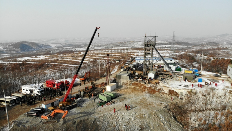 In this photo released by China's Xinhua News Agency, rescuers work at the site of a gold mine that suffered an explosion in Qixia in eastern China's Shandong Province, Wednesday, Jan. 13, 2021. (Wang Kai/Xinhua via AP)