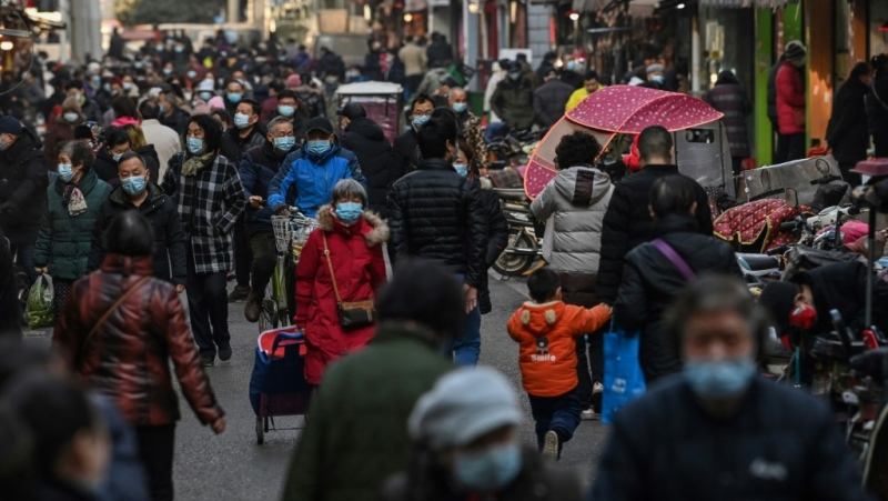 The new normal in Wuhan is much like the old reality; cars buzz down highways, sidewalks bustle with shoppers and public transport is busy. (AFP)