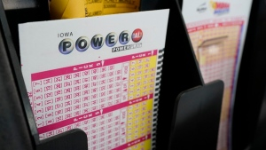 Blank forms for the Powerball lottery sit in a bin at a local grocery store in Des Moines, Iowa. (Charlie Neibergall / AP)