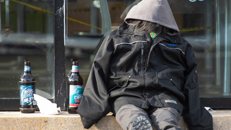 A homeless person braves the cold, Tuesday, January 19, 2021 in Montreal. The city has asked that Quebec exempt the homeless from the province's COVID-19 curfew.THE CANADIAN PRESS/Ryan Remiorz