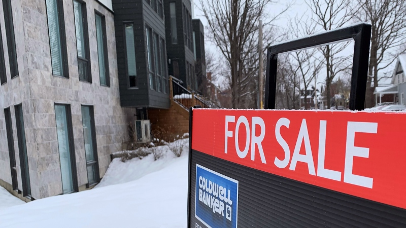 "A ""for sale"" sign is shown in Ottawa on Tuesday, Jan. 19, 2021. (THE CANADIAN PRESS / Craig Wong)"