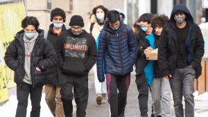 People walk downtown as COVID-19 lockdown measures continue in Montreal, Monday, January 18, 2021.THE CANADIAN PRESS/Ryan Remiorz