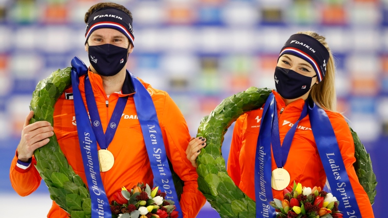 New European Champions Sprint Netherlands' Thomas Krol, left, and Netherlands' Jutta Leerdam pose during the award ceremony of the European Speedskating Championships Allround and Sprint at the Thialf ice arena in Heerenveen, northern Netherlands, Sunday, Jan. 17, 2021. (AP Photo/Peter Dejong)