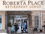 A visitor arrives at the Roberta Place Long Term Care home in Barrie, Ont. on Monday, January 18, 2021. The home has seen an outbreak of COVID-19 among staff and residents. THE CANADIAN PRESS/Frank Gunn