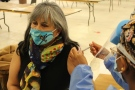 A 66-year-old Samson Cree resident receives the COVID-19 vaccine on Wednesday, Jan. 20, 2021. (Maskwacis Health Services)