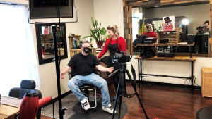 Owner of Crome Artistic Barber Alicia Hirter is seen cutting a client's hair on Jan. 21. (Supplied)