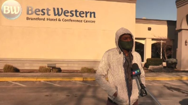 Akole Moses, a Schuyler Farms Ltd. migrant worker, stands outside the Best Western hotel in Branford, Ont. on Thursday, Jan. 21, 2021. (Reta Ismail / CTV News)