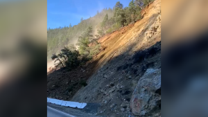 Employees of the California Department of Transportation were working nearby when a landslide spilled onto a quiet highway.