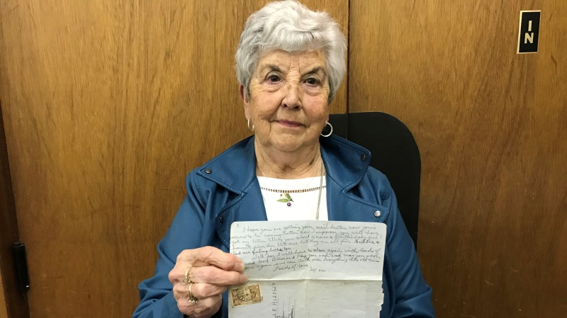 Marlene Dow is pictured with the 77-year-old letter her mother sent to her brother, who was stationed in England during WW II. (Cally Stephanow / CTV News)