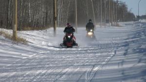 Barry Bradshaw (left) and Danny Wasylenchuk ride a trail near Good Spirit Acres on Jan. 21. (Kaylyn Whibbs/CTV News)
