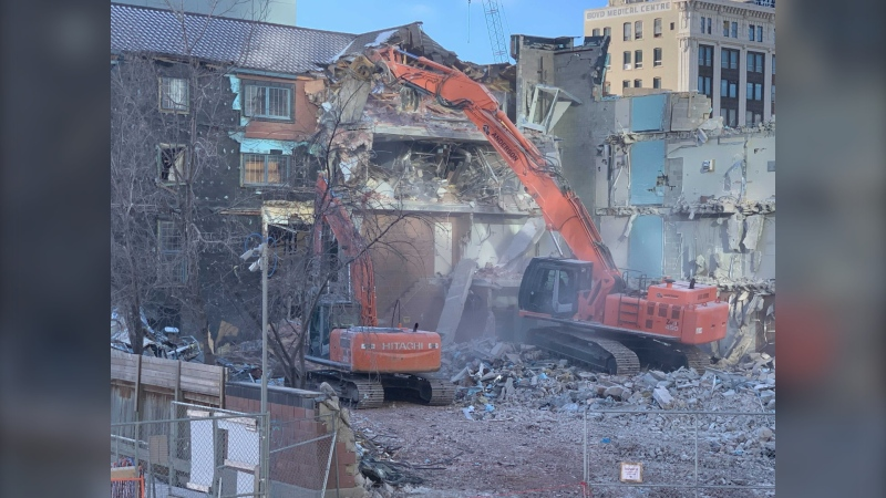A former dormitory building at the Royal Winnipeg Ballet building is demolished on January 21, 2021. (CTV News Photo Jamie Dowsett)