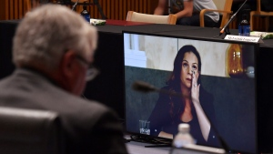 Mel Silva, right, the managing director of Google Australia and New Zealand, appears via a video link during a Senate inquiry into a mandatory code of conduct proposed by the government at Parliament House in Canberra, Friday, Jan. 22, 2021. (Mick Tsikas/AAP Image via AP)