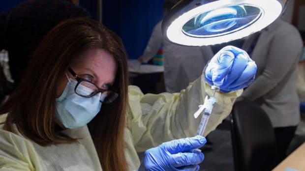 A dose of the Pfizer-BioNTech COVID-19 vaccine is prepared by Pharmacy Technician Supervisor Tamara Booth Rumsey at The Michener Institute in Toronto on Monday January 4, 2021. THE CANADIAN PRESS/Frank Gunn