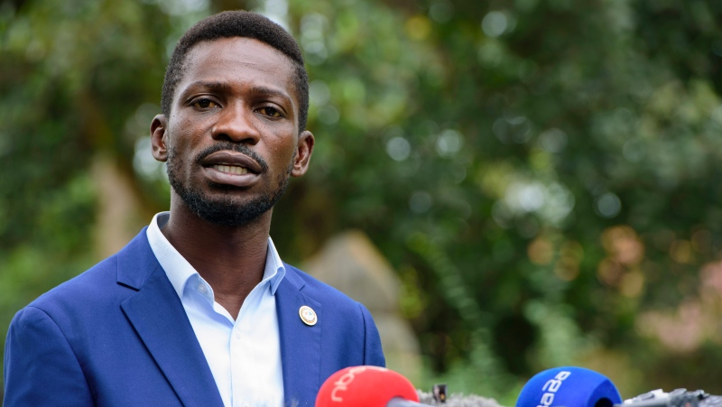 The National Unity platform presidential candidate Bobi Wine addresses the media at his home in Magere, Uganda, Friday, Jan. 15, 2021.  (AP Photo/Nicholas Bamulanzeki)