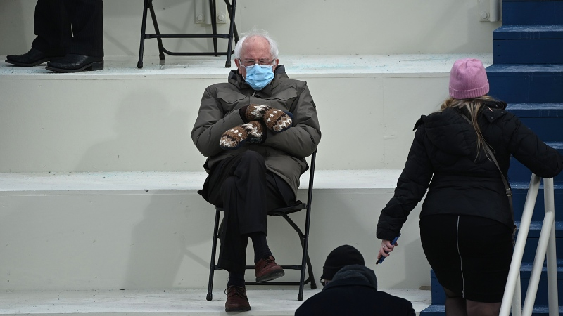 Former presidential candidate, Senator Bernie Sanders sits in the bleachers on Capitol Hill before Joe Biden is sworn in as the 46th US President on January 20, at the US Capitol in Washington, DC. T (Brendan Smialowski/AFP/Getty Images via CNN)