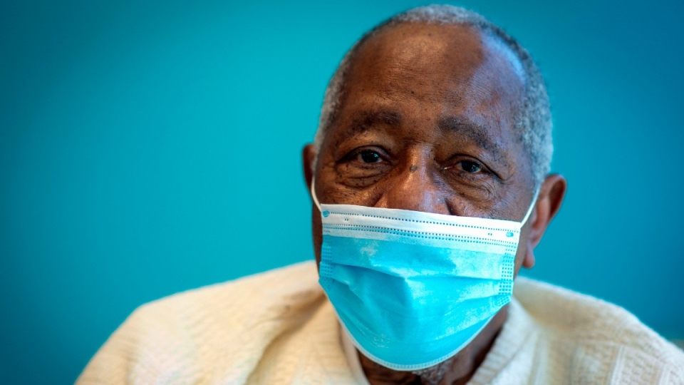 Baseball Hall of Famer Hank Aaron sits for a portrait after receiving his COVID-19 vaccination in Atlanta, on Jan. 5, 2021. (Ron Harris / AP)