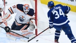 Edmonton Oilers goaltender Mikko Koskinen (19) makes a save against Toronto Maple Leafs centre Auston Matthews (34) during second period NHL hockey action in Toronto on Wednesday, January 20, 2021. THE CANADIAN PRESS/Nathan Denette