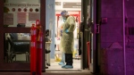 A health-care worker pauses during a lull in visitors at a COVID-19 testing centre in Toronto, Sunday, Dec. 20, 2020. THE CANADIAN PRESS/Chris Young