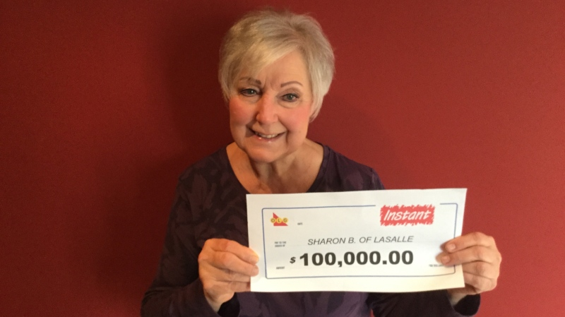 Sharon Brunette with her $100,000 cheque. (courtesy OLG)
