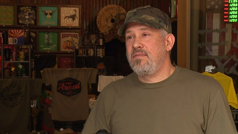 Arizona store owner pulls gun on mask-wearing man