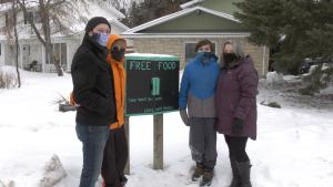 From left to right: Rob Dudiak, Finley Dudiak, Graham Dudiak, and Joanne Dudiak with the food donation box (Chad Leroux/CTV News)