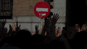 In this file photo dated Friday, June 22, 2018, protesters demonstrate while blocking the street outside the Justice Ministry in Madrid, Spain. The first comprehensive internal inquiry on sex abuse allegations by a religious order in Spain has identified 81 children and 37 adult victims by 96 Jesuits since the late 1920s, in a report released Friday Jan. 22, 2021, but associations of victims say it falls short of identifying perpetrators or those who covered up the abuses. (AP Photo/Paul White, FILE)