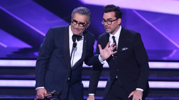 Eugene Levy, left, and his son Dan Levy accept the Best Comedy Series Award for 'Schitt's Creek' at the Canadian Screen Awards in Toronto on Sunday, March 13, 2016. THE CANADIAN PRESS/Peter Power