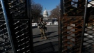 U.S. National Guard troops stand guard outside the Capitol as the security perimeter continues to shrink and many Guard units head home, two days after the inauguration of President Joe Biden on Friday, Jan. 22, 2021 in Washington.(AP Photo/Rebecca Blackwell)