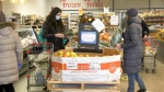 Shoppers at the European Deli and Produce Market on Friday supporting the 'local helping local' initiative.