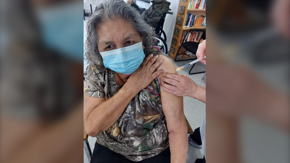 Joyce Rena Ryder receives her vaccine shot on Thursday on Carry The Kettle First Nation. (Supplied: Shawn Spencer)