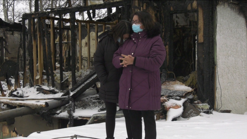 Belinda-Lee Krienke (right) and granddaughter Israella Dieter reflect on the wreckage of what used to be there home. (Kaylyn Whibbs / CTV News)